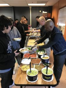 AUL Board Members help serve lunch for the school's pre-Winter Break Celebration